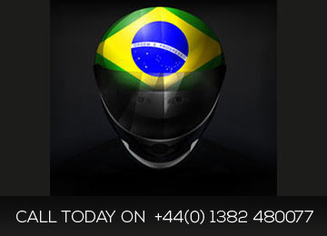 racing driver with brazil flag on his helmut